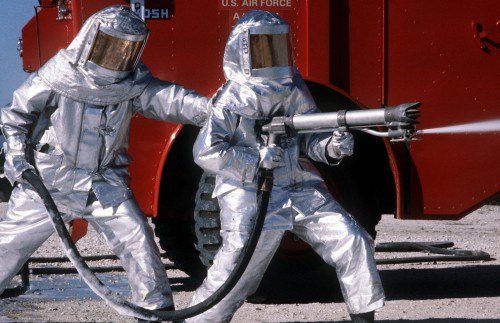 Fire_fighters_practice_with_spraying_equipment,_March_1981